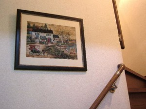 クロスステッチ風景画を額装して壁に